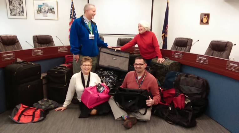 Optimist Club Collects Luggage for Friends of Foster Kids